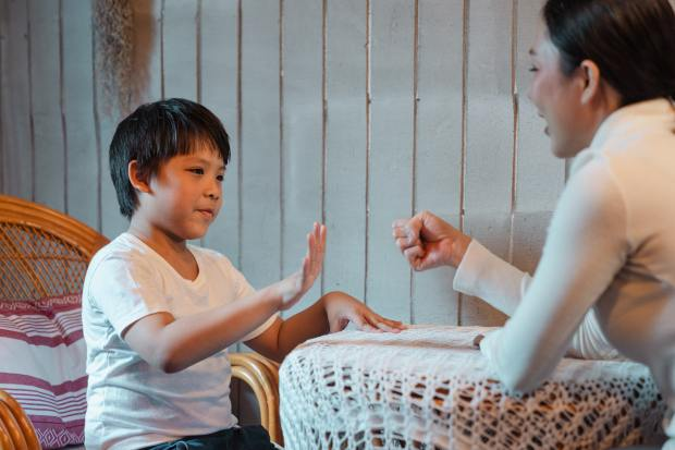 mother-and-son-playing-rock-paper-scissors-game-4472822.jpg